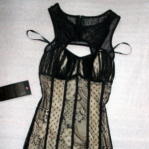 bebe Dresses - Bebe beige black overall lace cutout bustier dress